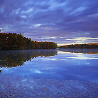 Experienced a katahum sunrise and morning the other day at Lake Cochituate. This urban lake borders the Boston suburbs Natick, Wayland and Framingham and is part of the Cochituate State Park in Massachusetts. There was still fall foliage colors to experience. The early morning light raw a beautiful light on this New England nature scenery, coloring it in glorious colors and hues. I love experience the quietude that comes with an early morning photo outing and needed it that morning. <br />