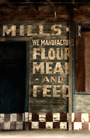 Faded sign advertising flour meal and feed