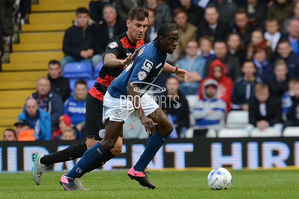 Birmingham City striker Clayton Donaldson holds the ball up from Queens Park Rangers defender Grant Hall during the Sky Bet Championship match between Birmingham City and Queens Park Rangers at St Andrews, Birmingham, England on 17 October 2015. Photo by Alan Franklin.