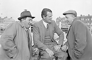 Dublin Cattle Market. Waiting for business- Sam Deverell, Tullamore, Co. Offlay, and his brother, Robert (right), chatting with Eric Meredith, Athy, Co. Kildare, at the sheep pens..25.04.1962