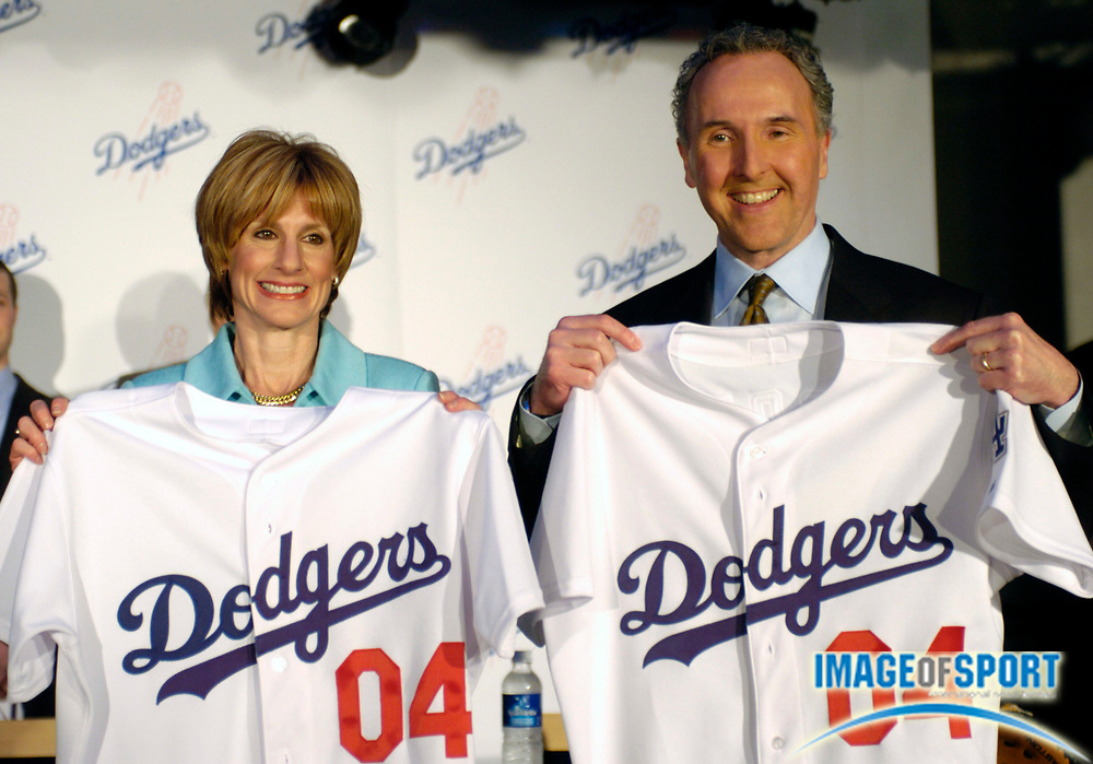 Jan 29, 2004; Los Angeles, CA, USA: Los Angeles Dodgers owners Jamie McCourt (left) and Frank McCourt hold jerseys at press conference announcing  purchase of team at Dodger Stadium.