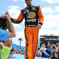 Race car driver Martin Truex Jr. is seen during driver introductions prior to the 58th Annual NASCAR Daytona 500 auto race at Daytona International Speedway on Sunday, February 21, 2016 in Daytona Beach, Florida.  (Alex Menendez via AP)