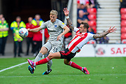 Chris Maguire (#7) of Sunderland AFC attempts to block a pass from Ross McCrorie (#15) of Portsmouth FC during the EFL Sky Bet League 1 match between Sunderland and Portsmouth at the Stadium Of Light, Sunderland, England on 17 August 2019.