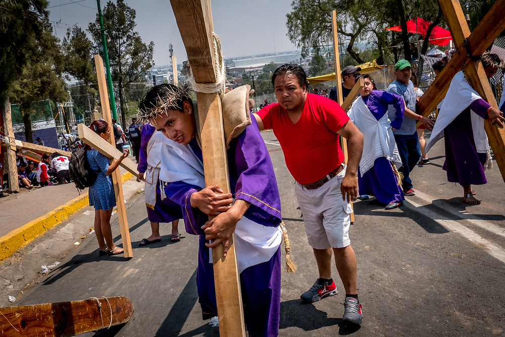 Devotees dressed as Nazarenes drag wooden crosses up the Cerro de Estrella, Iztapalapa's tallest moutnain. Each cross weighs approximately 100kg (220lbs.) and the participants need to work in teams to avoid physical exhaustion.