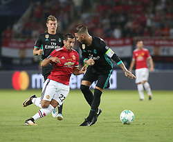 August 8, 2017 - Skopje, Macedonia - Henrikh Mkhitaryan of Manchester United vies Sergio Ramos of Real Madrid during the UEFA Super Cup match between Real Madrid and Manchester United at Philip II Arena on August 8, 2017 in Skopje, Macedonia. (Photo by Raddad Jebarah/NurPhoto) (Credit Image: © Raddad Jebarah/NurPhoto via ZUMA Press)