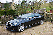 Black Mercedes C350 sport saloon car, Cotswolds, Oxfordshire, United Kingdom