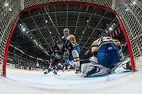 KELOWNA, CANADA - DECEMBER 1:  Conner Bruggen-Cate #20 of the Kelowna Rockets tries to put the puck in the net of Nolan Maier #73 while checked by Brandon Schuldhaus #6 of the Saskatoon Blades on December 1, 2018 at Prospera Place in Kelowna, British Columbia, Canada.  (Photo by Marissa Baecker/Shoot the Breeze)