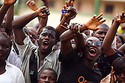 "Students cheer during the visit of Guinea's president Captain Moussa Dadis Camara at the Kofi Annan private university in Conakry, Guinea on Thursday March 5, 2009. Camara, who took power after a coup in December 2008, was visiting the university to ""meet the youth"", as part of his efforts to solidify his support from Guinea's population.(Olivier Asselin for the New York Times)"