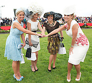 Rachelle Guiry, winner of Anthony Ryans Best Dressed Lady Competition, the winner of the Anthony Ryans Best Hat Competition  Alex Butler  and the winner of the Anthony Ryans Wear Irish Award Aisling Maher  with special guest judge Kathryn Thomas at the ladies day of The Galway Races. Photo:Andrew Downes