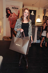 KATE FORD at a party to celebrate the opening of the new Mina Store at 36-38 Great Titchfield Street, London W1W 8BQ on 9th September 2010.  The party was sponsored by Ivan the Terrible Vodka.