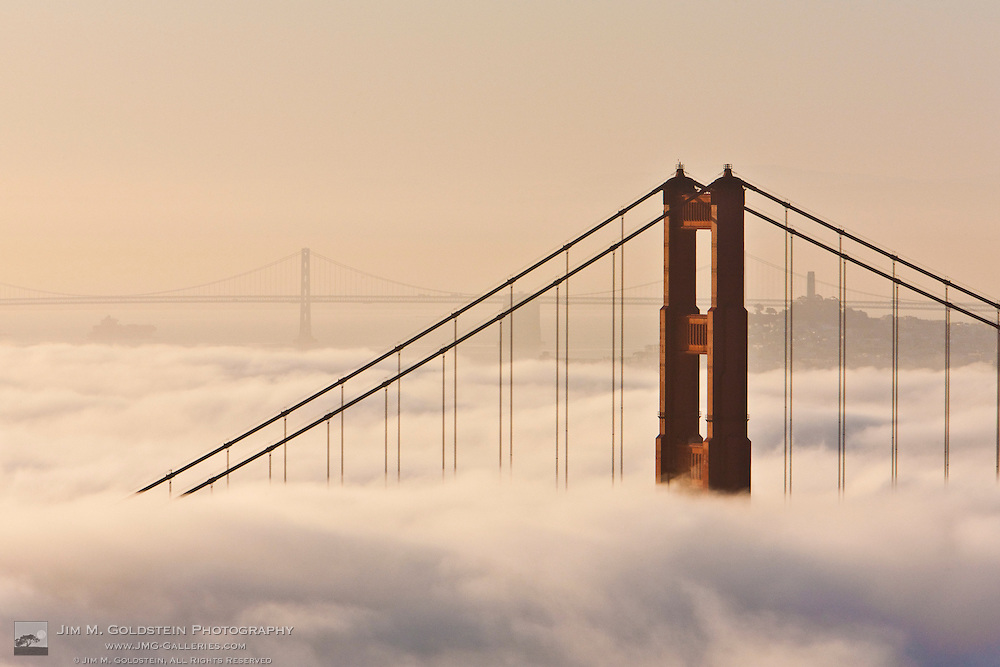 Fog shrouds the Golden Gate Bridge at Sunrise - San Francisco, California