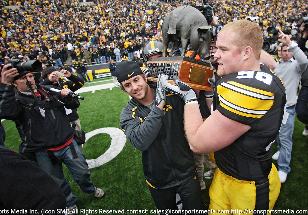November 21, 2009: Iowa running back Jayme Murphy (17) and Iowa defensive tackle Chad Geary (98) carry the Floyd of Rosedale trophy after the Iowa Hawkeyes 12-0 win over the Minnesota Golden Gophers at Kinnick Stadium in Iowa City, Iowa on November 21, 2009.