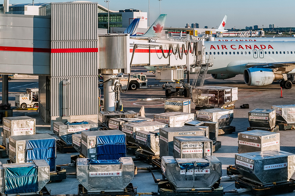 Loading planes at Vancouver International Airport, British Colombia, Canada.