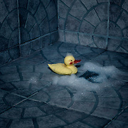a rubber duck with foam sitting in a shower