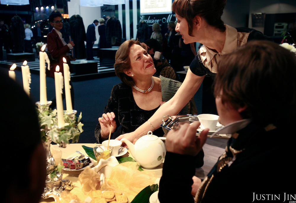 A woman drinks tea at the Millionaire Fair in Moscow. .Millionaires, billionaires and those who bought 1,000-rouble tickets were among the thousands who visited the fair held in the Crocus city expo centre. .The four-day event, held for the second year in a row, ended on October 30. The products on sale include a diamond-studded mobile phone worth a million dollars, an island, latest sports cars and other items that might appeal to the growing millionaire market..Twenty years ago, there were no official millionaires in the whole of Russia. Now Moscow has 25 billionaires and the country has 88,000 millionaires, according to Forbes Magazine. ..