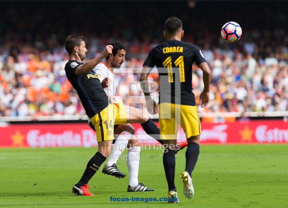 Daniel Parejo of Valencia CF and Gabi Fernandez of Atletico Madrid during the La Liga match at Mestalla, Valencia<br /> Picture by Maria Jose Segovia/Focus Images Ltd +34 660052291<br /> 02/10/2016
