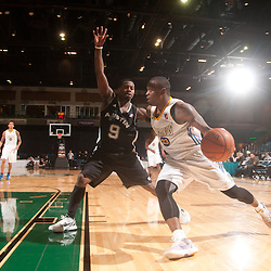 RENO, NV - JANUARY 12:  Maurice Baker #23 of the Dakota Wizards drives to the baseline against Justin Dentmon #9 of the Austin Toros during the 2012 NBA D-League Showcase on January 12, 2012 at the Reno Events Center in Reno, Nevada.  NOTE TO USER: User expressly acknowledges and agrees that, by downloading and or using this photograph, User is consenting to the terms and conditions of the Getty Images License Agreement. Mandatory Copyright Notice: Copyright 2012 NBAE  (Photo by David Calvert/NBAE via Getty Images) *** Local Caption *** Maurice Baker;Justin Dentmon