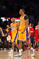 22 March 2013: Center (12) Dwight Howard of the Los Angeles Lakers and teammate (24) Kobe Bryant walk off the court against the Washington Wizards late during the second half of the Wizards 103-100 victory over the Lakers at the STAPLES Center in Los Angeles, CA.