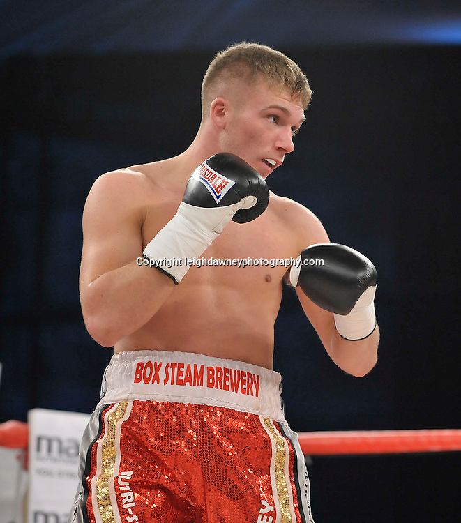 Nick Blackwell defeats Nathan King in a middleweight boxing contest at Glow, Bluewater, Kent on the 8th November 2014. Promoter: Hennessy Sports. © Leigh Dawney Photography 2014.