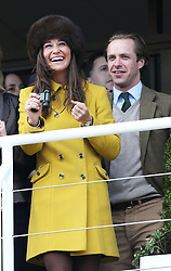 Pippa Middleton and Tom Kingston watching the racing at Cheltenham Festival, Thursday, 14th  March 2013.  Photo by: Stephen Lock / i-Images