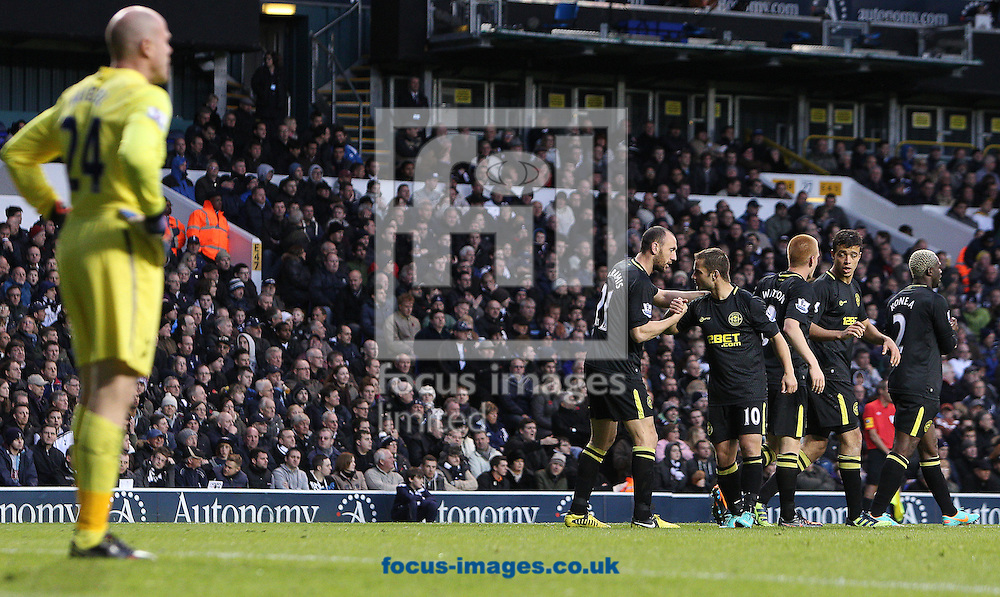 Picture by Paul Terry/Focus Images Ltd +44 7545 642257.03/11/2012.Brad Friedel ( L ) of Tottenham Hotspur looks dejected as Ben Watson ( 3rd R) of Wigan Athletic celebrates with team mates after scoring to make it 1-0 during the Barclays Premier League match at White Hart Lane, London.