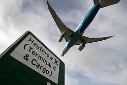 "© Licensed to London News Pictures. 27/10/2016. London, UK. An airliner comes into land at Heathrow Airport. The government has announced that a third runway will be built at the United Kingdom's busiest airport. The Cabinet are divided - with Foreign Secretary Boris Johnson saying that the project is ""undeliverable"". Conservative MP for Richmond Zac Goldsmith has resigned. Photo credit: Peter Macdiarmid/LNP"
