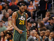 Mar. 14, 2012; Phoenix, AZ, USA;  Utah Jazz center Al Jefferson (25) walks off the court while playing against the Phoenix Suns during the second half at the US Airways Center.  The Suns defeated the Jazz 120-111. Mandatory Credit: Jennifer Stewart-US PRESSWIRE.
