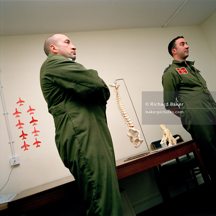 Two ground support staff of the 'Red Arrows', Britain's Royal Air Force aerobatic team listen to a health & safety brief.