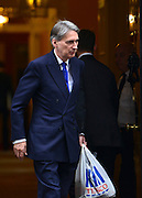 © Licensed to London News Pictures. 18/10/2012. Westminster, UK . Defence Secretary Philip Hammond leaves Downing Street passing a man holding a tesco carrier bag, today 18th October 2012. l. Photo credit : Stephen Simpson/LNP