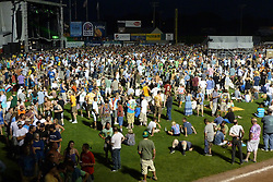 Sidelong night view of the field, fans and stage. Furthur Band at McCoy Stadium, Pawtucket RI on 5 July 2012