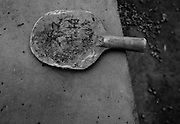 A battered old table tennis paddle is seen on a concrete table in a school yard in the poor province of Shanxi in western China.