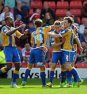 Jordan Clark (centre right) of Shrewsbury Town is congratulated on his goal during the Sky Bet League 1 match at Oakwell, Barnsley<br /> Picture by Graham Crowther/Focus Images Ltd +44 7763 140036<br /> 05/09/2015