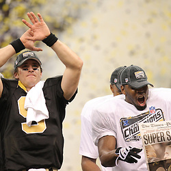 Jan 24, 2010; New Orleans, LA, USA; New Orleans Saints quarterback Drew Brees (9) and linebacker Jonathan Vilma (right) celebrate following a 31-28 overtime victory by the New Orleans Saints over the Minnesota Vikings in the 2010 NFC Championship game at the Louisiana Superdome. Mandatory Credit: Derick E. Hingle-US PRESSWIRE