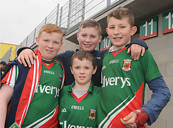 Belmullet boys Daniel, Francis and Paddy Dixon with Mark Harding at McHale park for the Mayo v Kerry national football league encounter. Pic Conor McKeown