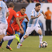 EAST RUTHERFORD, NEW JERSEY - JUNE 26:  Lionel Messi #10 of Argentina on the ball watched by Alexis Sanchez #7 of Chile during the Argentina Vs Chile Final match of the Copa America Centenario USA 2016 Tournament at MetLife Stadium on June 26, 2016 in East Rutherford, New Jersey. (Photo by Tim Clayton/Corbis via Getty Images)