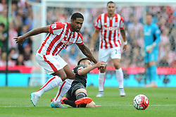 Glen Johnson of Stoke City challenges for the ball with Adam Lallana of Liverpool - Mandatory byline: Dougie Allward/JMP - 07966386802 - 09/08/2015 - FOOTBALL - Britannia Stadium -Stoke-On-Trent,England - Stoke City v Liverpool - Barclays Premier League