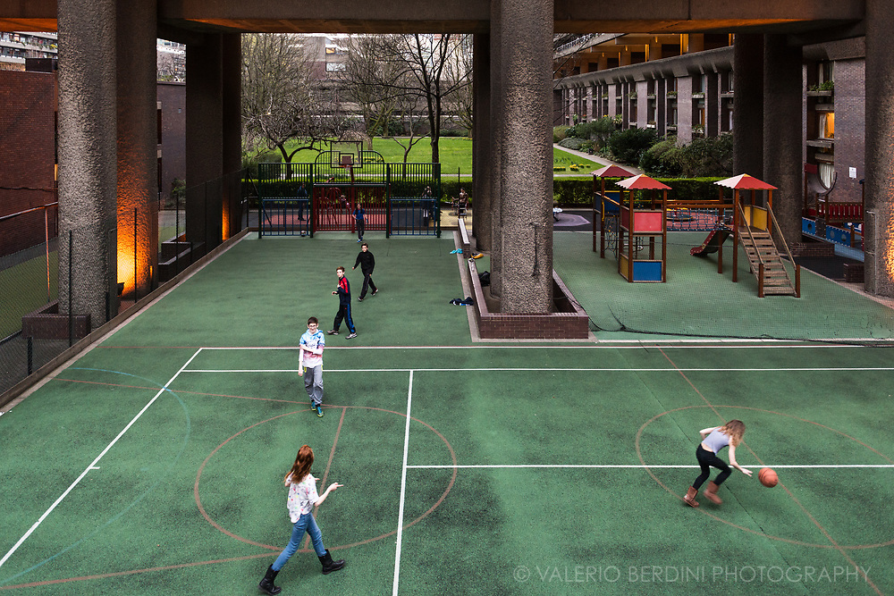 Children play within the closed walls of the exclusive kids playground of the Barbican complex in London. Only residents and their guests are allowed to stay.