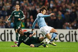 21.11.2012, Etihad Stadium, Manchester, ENG, UEFA Champions League, Manchester City vs Real Madrid, Gruppe D, im Bild Manchester City's David Silva in action against Real Madird CF's Xabi Alonso during during UEFA Champions League group D match between Manchester City and Real Madrid CF at the Etihad Stadium, Manchester, Great Britain on 2012/11/21. EXPA Pictures © 2012, PhotoCredit: EXPA/ Propagandaphoto/ David Rawcliffe..***** ATTENTION - OUT OF ENG, GBR, UK *****