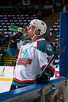 KELOWNA, CANADA - APRIL 7: Carsen Twarynski #18 of the Kelowna Rockets stands at the boards in front of the bench for water against the Portland Winterhawks on April 7, 2017 at Prospera Place in Kelowna, British Columbia, Canada.  (Photo by Marissa Baecker/Shoot the Breeze)  *** Local Caption ***