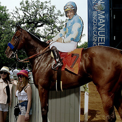 Fans pose with a wood cutout of American Pharoah and jockey Victor Espinoza as he makes his first public debut at Santa Anita since becoming the first racehorse to win the Triple Crown after winning the Kentucky Derby, Preakness and Belmont Stakes at Santa Anita Park in Arcadia, Calif., on Saturday, June 27, 2015.<br /> (Photo by Keith Birmingham/ Pasadena Star-News)
