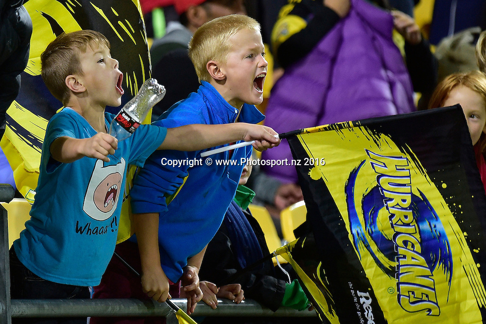 Hurricanes fans celebrate a try during the Hurricanes vs Kings Super Rugby  match at the Westpac Stadium in Wellington on Friday the 25th of March 2016. Copyright Photo by Marty Melville / www.Photosport.nz