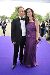 GEORDIE GRIEG and his wife KATHRYN at The Butterfly Ball in aid of the Caudwell Children Charity held in Battersea park, London on 14th May 2009.
