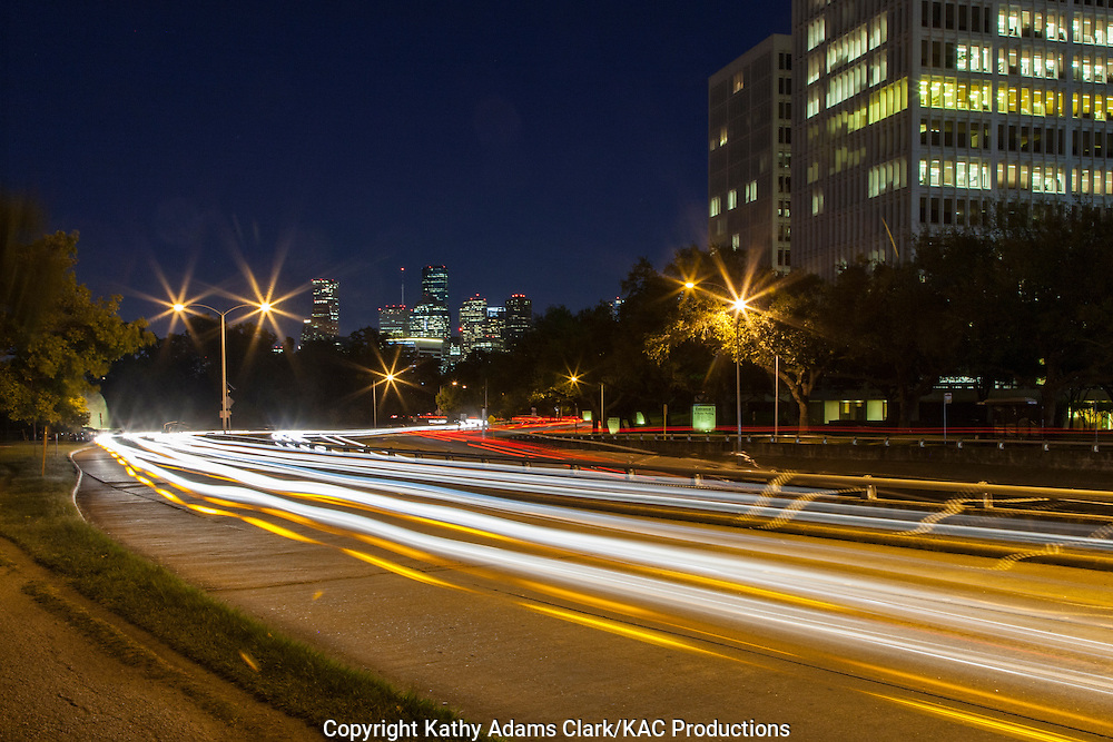 Streaking car lights on Allen Parkway in Houston, Texas at night.