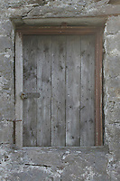 Wooden door in stone building