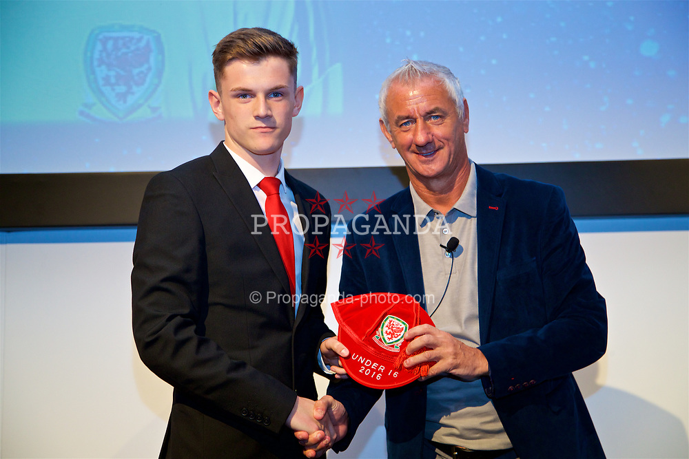 NEWPORT, WALES - Saturday, May 27, 2017: Luke Burton receives his Under-16 Wales cap from Wales' Elite Performance Director Ian Rush at the Celtic Manor Resort. (Pic by David Rawcliffe/Propaganda)