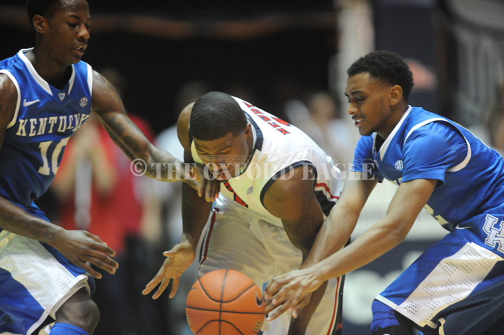 "Ole Miss' Martavious Newby (1) is fould by Kentucky's Ryan Harrow (12) and defended by Kentucky's Archie Goodwin (10) at the C.M. ""Tad"" Smith Coliseum on Tuesday, January 29, 2013.  (AP Photo/Oxford Eagle, Bruce Newman).."