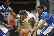 """Ole Miss' Martavious Newby (1) is fould by Kentucky's Ryan Harrow (12) and defended by Kentucky's Archie Goodwin (10) at the C.M. """"Tad"""" Smith Coliseum on Tuesday, January 29, 2013.  (AP Photo/Oxford Eagle, Bruce Newman).."""