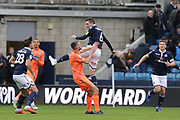 Millwall midfielder Shaun Williams (6) jumps for a high ball Millwall defender Ryan Leonard (28) during the EFL Sky Bet Championship match between Millwall and Ipswich Town at The Den, London, England on 27 October 2018.