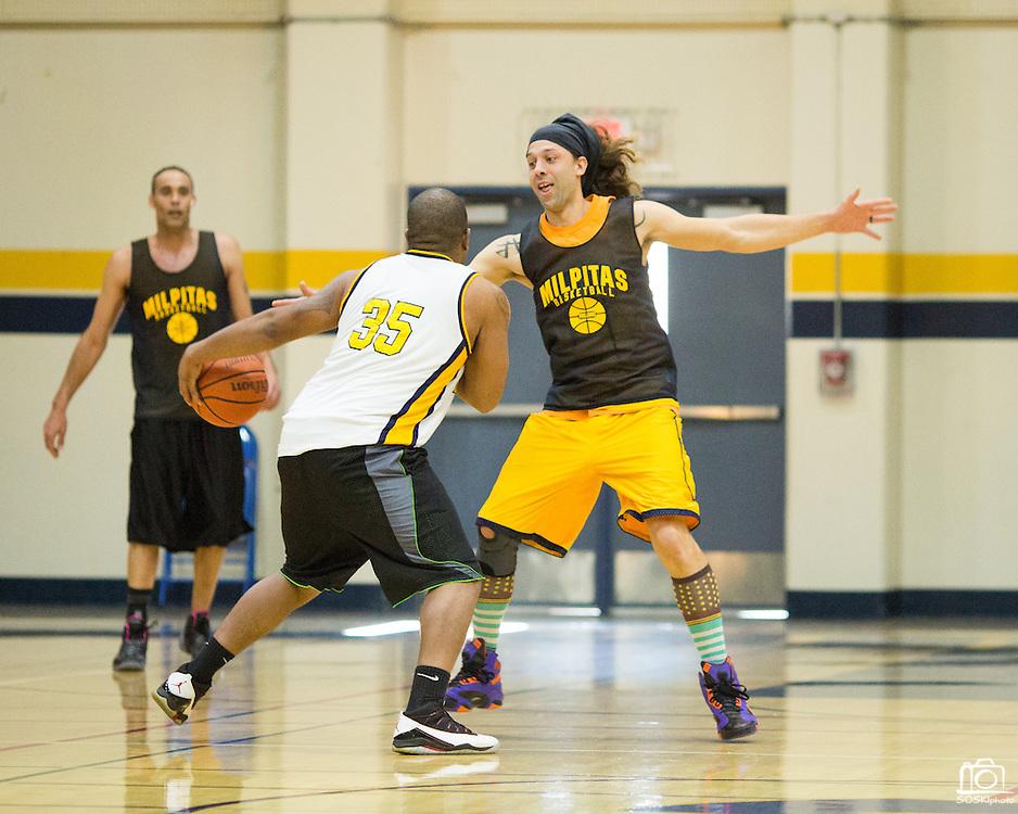 Class of 2000 alumni Michael Wright tries to stop the ball during the Milpitas High School Alumni Basketball Tournament at Milpitas High School in Milpitas, California, on January 3, 2015. (Stan Olszewski/SOSKIphoto)