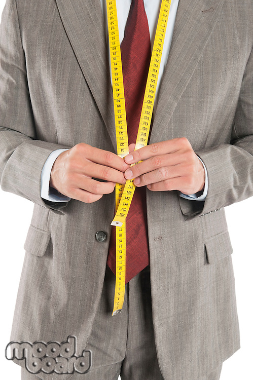 Man wearing a tape measure across his suit
